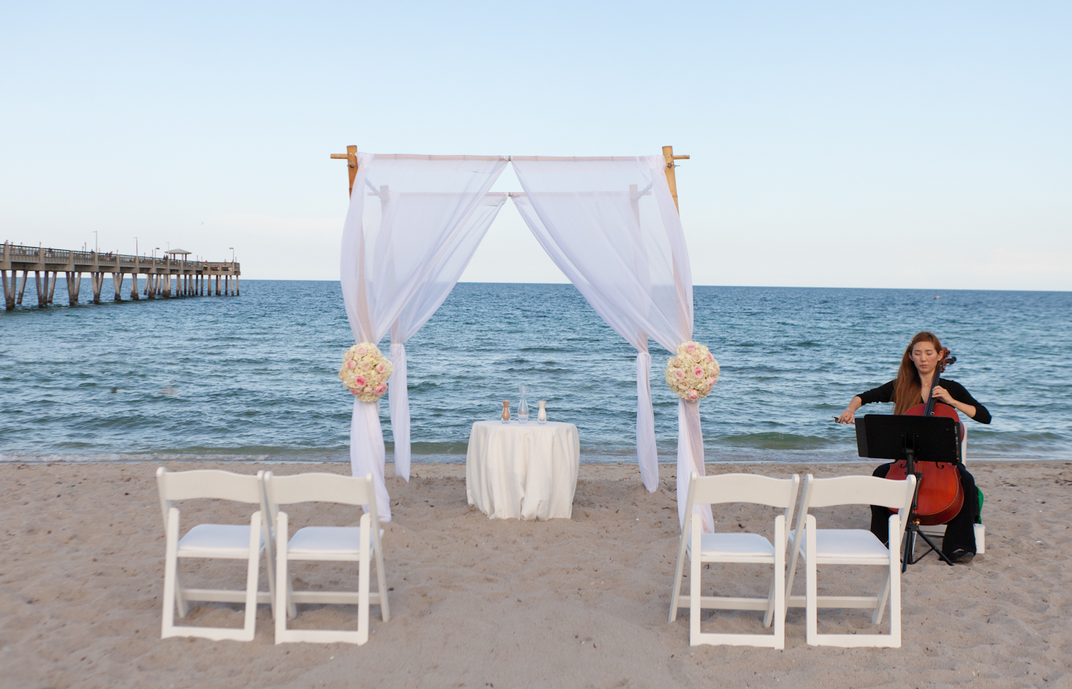Four Post Bamboo Arch With Flowers | Small Miami Weddings